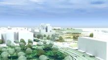 Der bygges nye karreer langs Østre Stationsvej, mens høje bygninger og butikscentret placeret nær ved jernbanens store rum